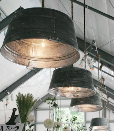 rustic reinvented ~ painted tin buckets turned into large scale event lighting.