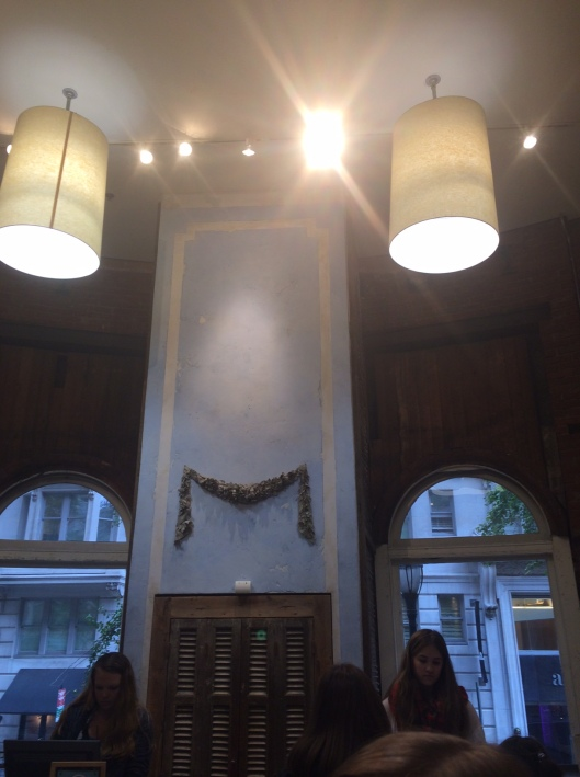 I took this picture at Anthropologie in Center City, Philadelphia.  The large shades bring the very tall ceiling down to a more human level at the checkout counters.