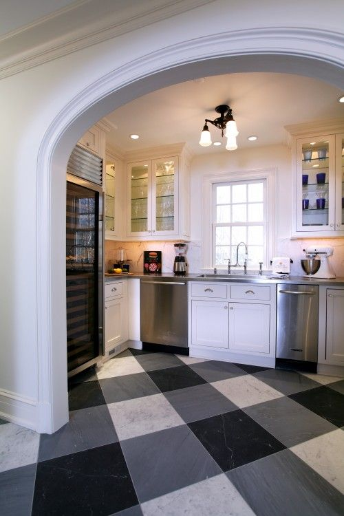 Here in marble gingham flooring set on the diagonal makes this kitchen bold and dynamic.  Tim Kriebel Design.