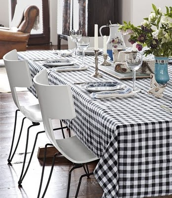 pairing modern chairs with a classic gingham tablecloth provides a fresh twist