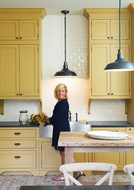 buttery yellow cabinets give a cheerful, traditional farm kitchen feel